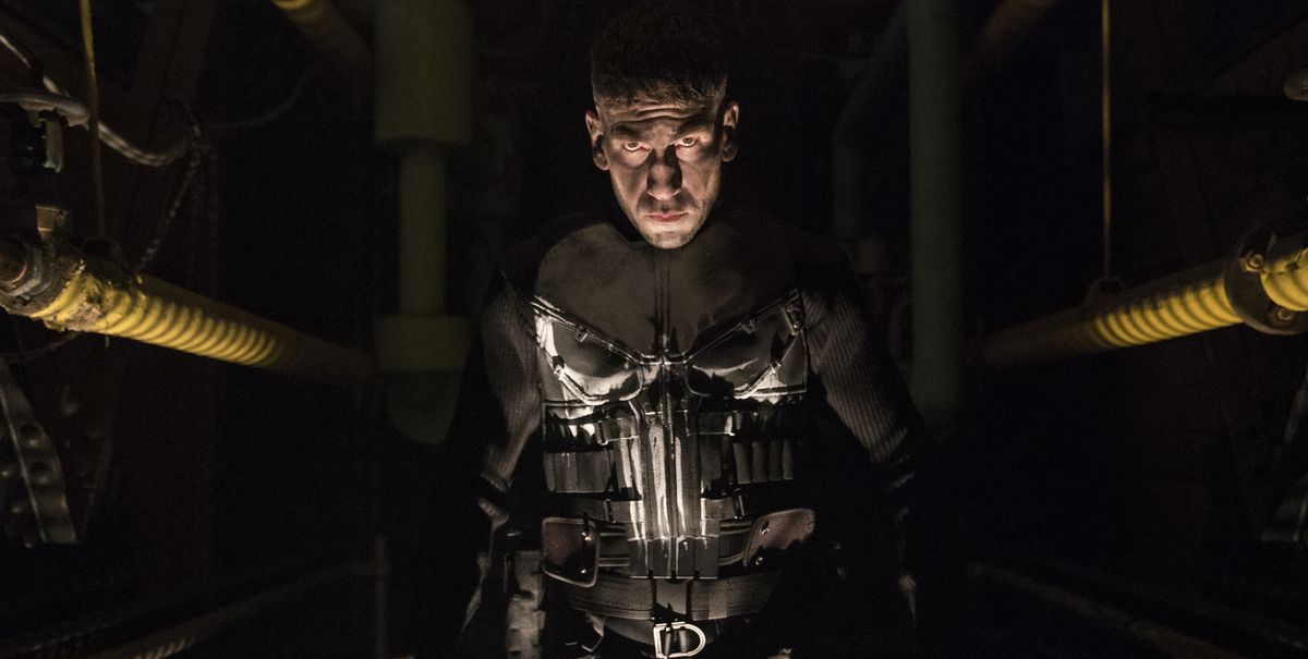 The Punisher using a massive gun.